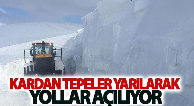 Kardan tepeler yarılarak yollar açılıyor